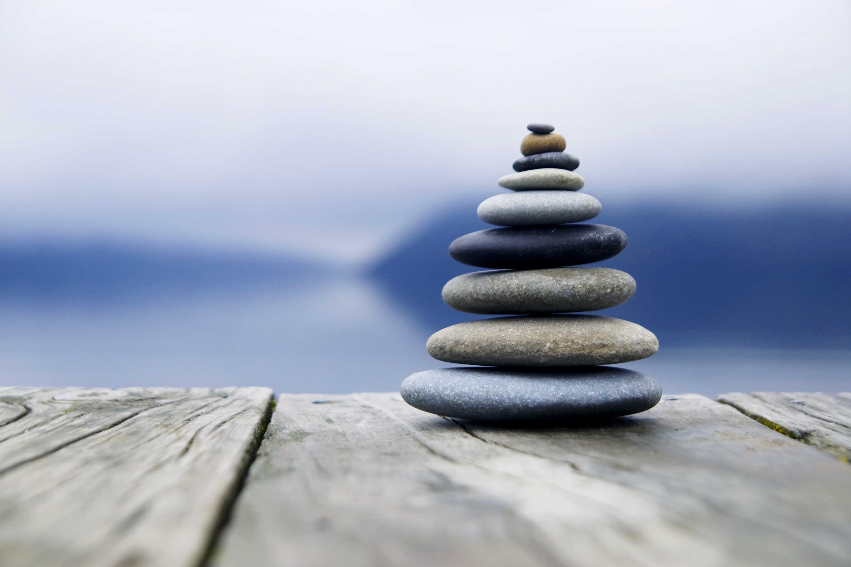Zen Balancing Rocks o a Deck, New Zealand | Larry Berkelhammer
